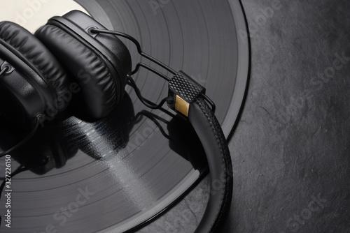 Fototapeta Over or on-ear headphones on vinyl record.