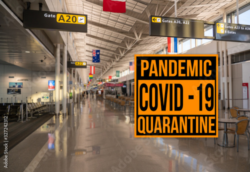mata magnetyczna Pandemic sign warning of quarantine due to Covid-19 or corona virus in the USA against background of empty airport terminal