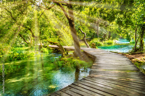 Fotografía Wooden footpath over river in forest of Krka National Park, Croatia