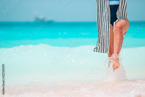 Woman's feet on the white sand beach in shallow water Принти на полотні