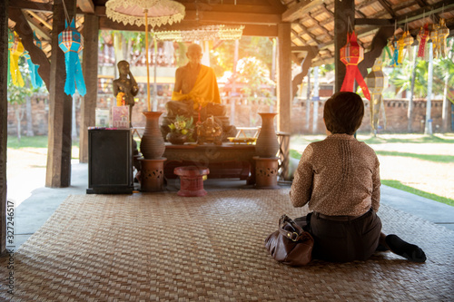 Thai buddhism people in buddhist pray for benefaction worship to Buddha at templ Wallpaper Mural