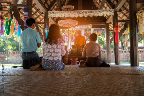 Photo Thai buddhism people in buddhist pray for benefaction worship to Buddha at templ