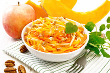 Salad Of Pumpkin And Apple In Bowl On Light Board