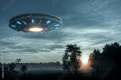 UFO, an alien plate hovering over the field, hovering motionless in the air Fotobehang