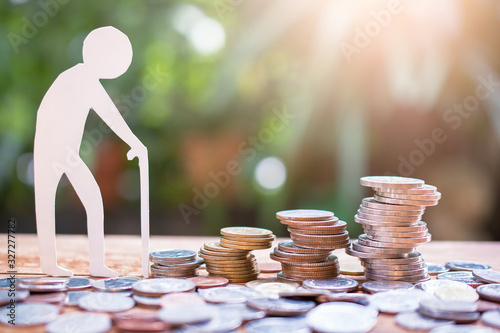 Fototapeta old man model set step on money coins saving for concept investment mutual fund finance and pension retirement obraz