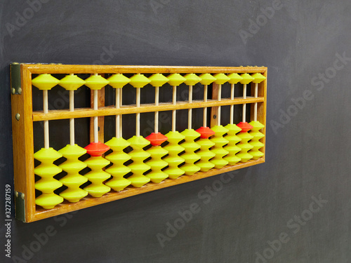 Photo Classes in mental arithmetic, abacus soroban on black background