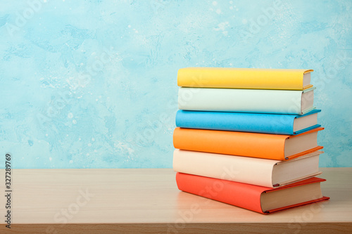 Fotomural Education concept with stack of books on wooden table