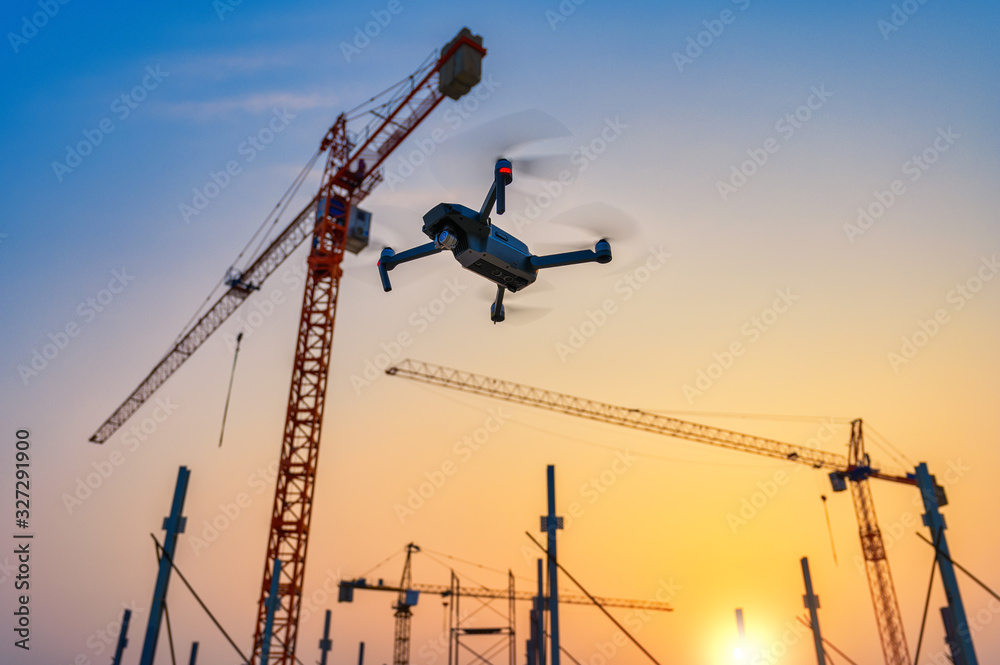 Fototapeta Drone over construction site. video surveillance or industrial inspection