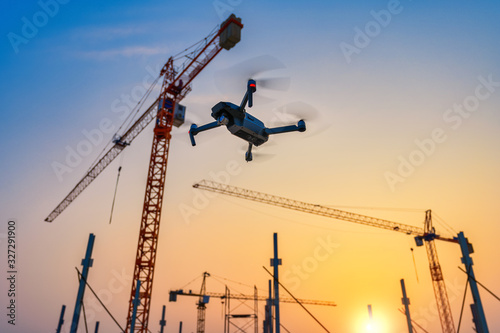 Obraz Drone over construction site. video surveillance or industrial inspection - fototapety do salonu