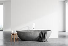 Stone Bathtub In Spacious White Bathroom