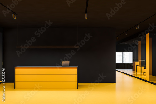 Bright yellow reception in black office hall Canvas Print