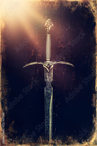Foto Magyc sword on moss background, old photo effect.