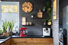 Wooden Clock On Black Brick Wa...