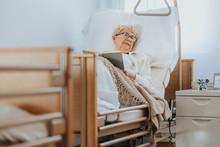Sick Senior Woman Lies In A Ho...