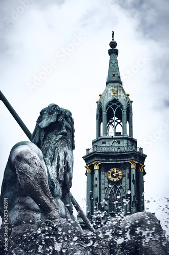 Neptune on fountain with church tower in the background Canvas Print
