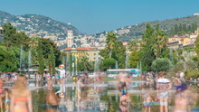 People Walk On A Promenade Du Paillon Park Timelapse, Famous With Its Flat Fountains In Nice, France.