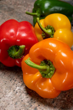 Fresh Red, Orange, Green And Yellow Sweet Bell Paprika