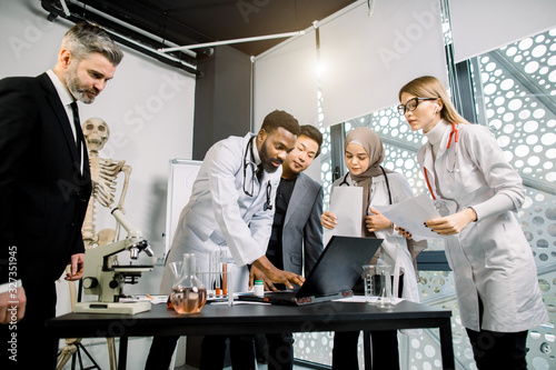 Multiethnic team of doctors, scientists, healthcare workers having a discussion, Wallpaper Mural