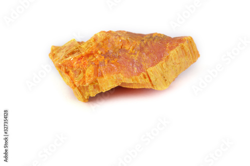 Photo Auripigment (orpiment, arsenic mineral) isolated on white