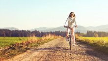 Young Woman Rides Bicycle On D...