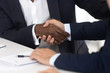 Close up of male handshake after effective negotiation