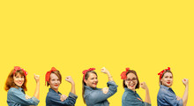 Women With A Clenched Fist Rolling Up Their Sleeves On Yellow Background, Copy Space, Tribute To The Icon Rosie Riveter. Girl Power Concept. Women's Day.