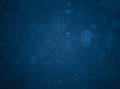 Abstract blue bokeh background. Defocused background. Blurred bright light.
