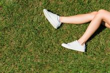 Female Legs In White Sneakers ...