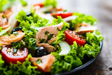 Salmon Salad - Roasted Salmon And Vegetables On Wooden Background