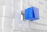 Blue cube in front of wall of white cubes, software module, teamwork or standing out from the crowd leadership concept