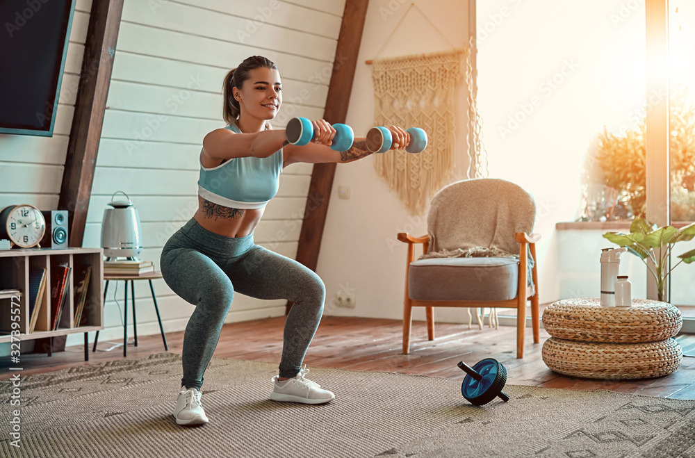 Fototapeta Woman doing exercises at home.