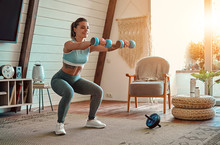 Woman Doing Exercises At Home.