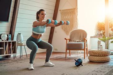 Fototapeta na wymiar Woman doing exercises at home.