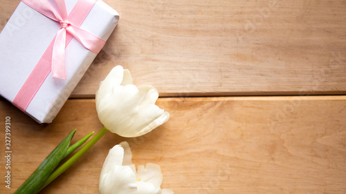 Fototapeta White tulips and gift box on wooden background, copy space for the text obraz na płótnie