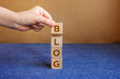 Blog. Technology Concept. Hand holding wood cube block.