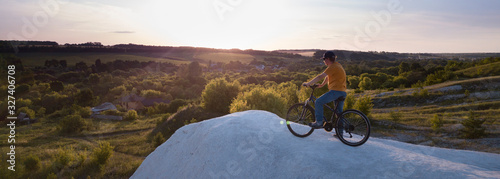Obraz Mountain bike.Sport and healthy life.Extreme sports.Mountain bicycle and man.Life style outdoor extreme sport - fototapety do salonu