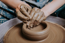 Woman Hands Working On Pottery...