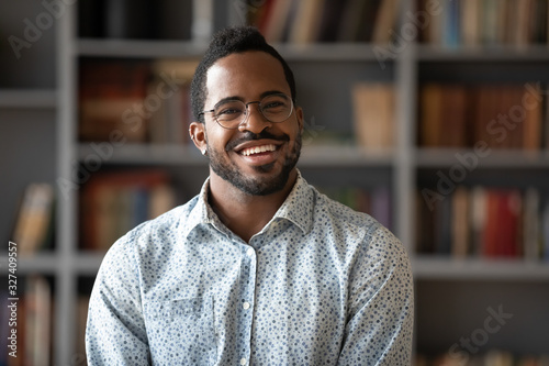 Fototapety, obrazy: Head shot portrait of happy young african american businessman.