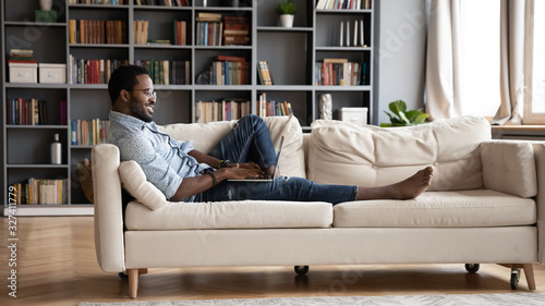Smiling young biracial guy dating, spending leisure time online. Canvas Print