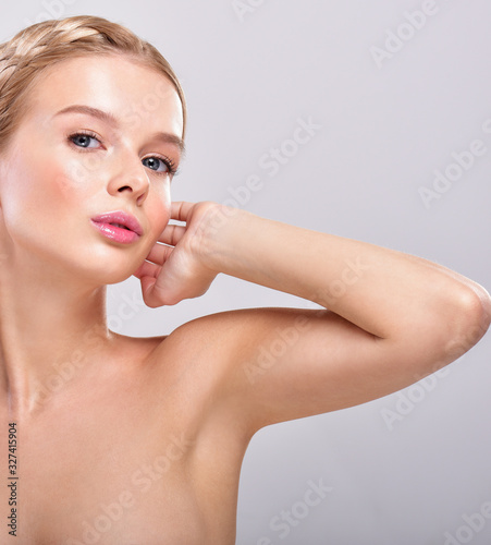 Beautiful young woman holding her arms up and showing clean underarms Canvas Print