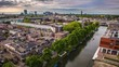 Utrecht city from top. General view from old tower at summer evening. 4K Time Lapse 2 in 1.