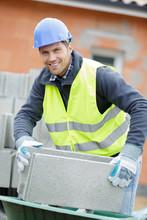 A Happy Man Shifting Cement Blocks