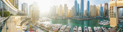 Dubai Marina panorama in morning sunlight, boats and yachts in water canal with modern skyscrapers buildings Wallpaper Mural