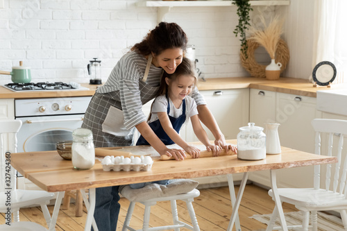 Fototapeta Happy mother and little daughter baking together obraz