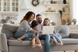 Leinwandbild Motiv Happy family with kids sit on couch using laptop
