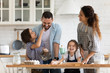 canvas print picture - Overjoyed parents with little kids have fun cooking in kitchen