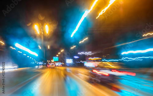 Photo City colorful night lights perspective blurred by high speed of the car