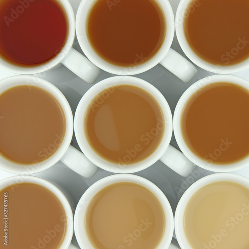 Obraz Overhead photo of a spectrum of different strength of tea  - fototapety do salonu