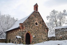 Stone Castle Chapel On A Snowy...