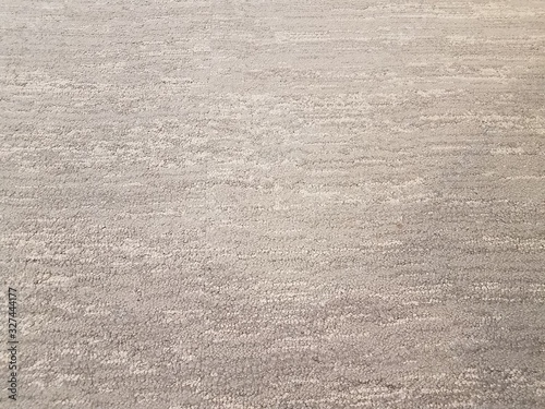 grey carpet or rug or textile on floor or ground